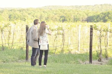 Johnson Estate Winery couple in vineyard